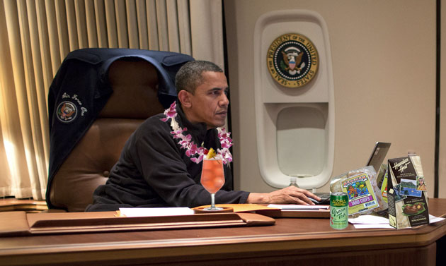 President Obama on Air Force One heading to Hawaii - drinking a mai tai