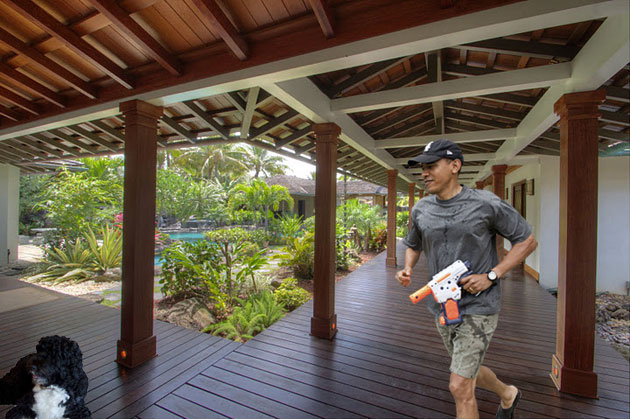 President Obama shoots Bo with a water gun in Hawaii